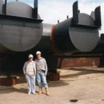 The pontoon designer Shane Carr and his Father pose to show the proportions of the huge structure